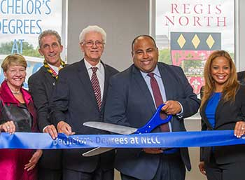 A photo of the ribbon cutting at Regis North on the NECC campus in Lawrence