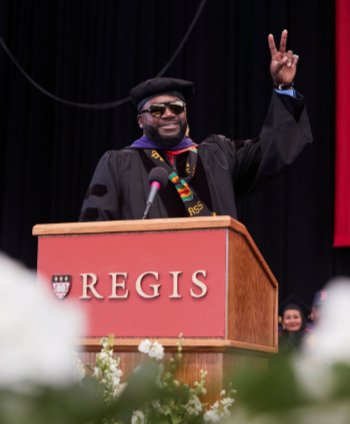 David Ortiz gives the victory sign after addressing the graduates