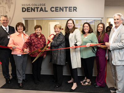 President Hays cuts the ribbon at the new Waltham Dental Center