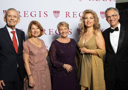 A photo of Patricia D'Amore '73 with John Tegan, President Hays, Haleh Azar and Ali Shajii