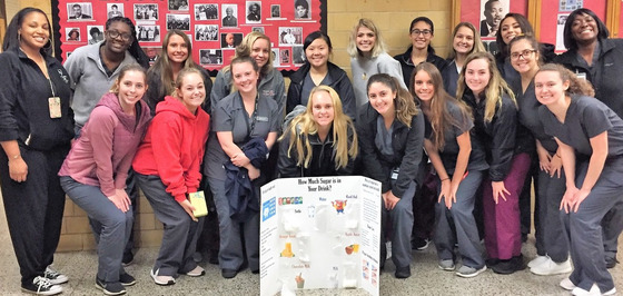 Dental hygiene students pose for a photo at the Dr. Martin Luther King Jr. K-8 School in Dorchester