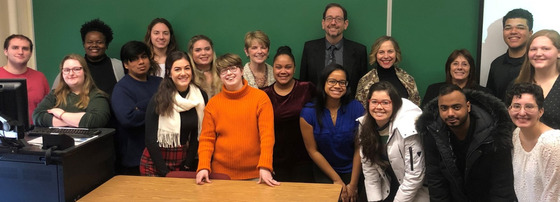 The Writing for the Communication Professional class poses during their end of semester project presentation