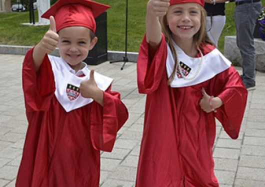 Children's Center graduates in their red cap and gowns