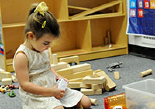 Children's Center student playing with blocks