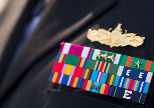 Photo of a military uniform with block of award badges