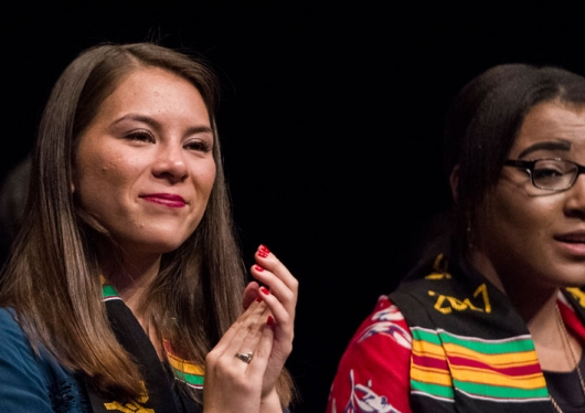 Three students wearing their Kente Stoles for commencement