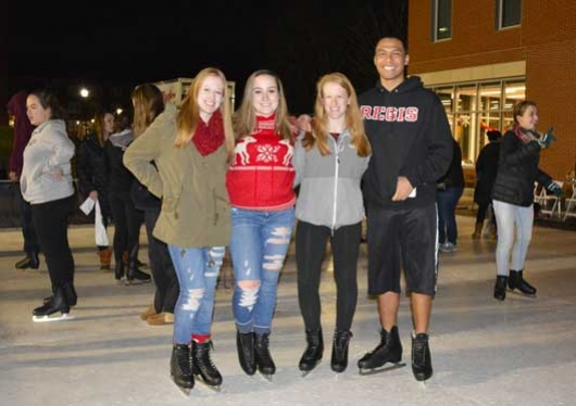 Regis College students at annual christmas tree lighting celebration