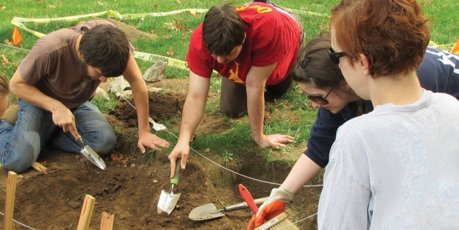 Regis Students digging in dirt