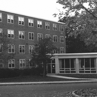 A black and white photo of the entrance to Angela Hall