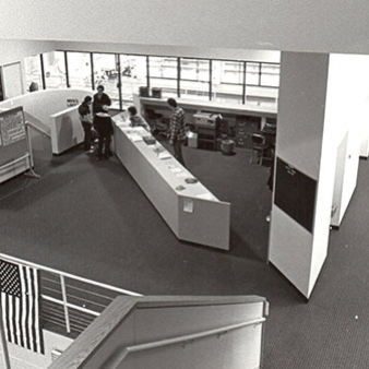 A black and white photo of the reception area of the athletic facility