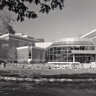A black and white photo of the entrance to the Fine Arts Center