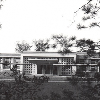 A black and white photo of the entrance to the Regis College Student Center