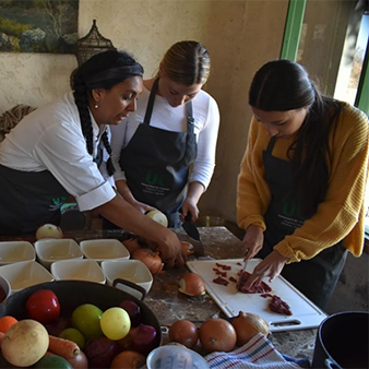 Larissa Ribas and others prepare food in Argentina