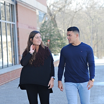 Two students walking along the Great Walk on Regis' Weston campus