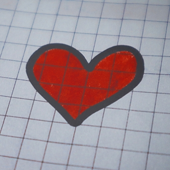 Drawing of a red heart on graph paper