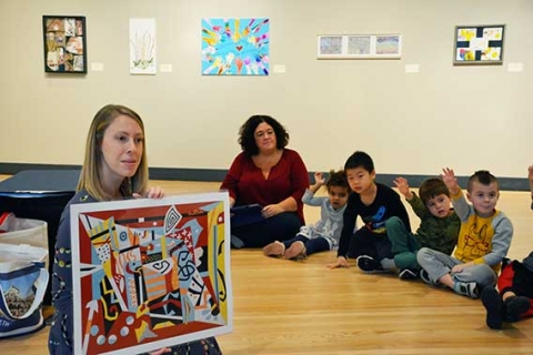 Lauren Yockel presents art to students of the Children's Center