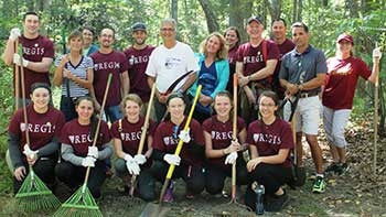 Members of the Regis community pose while working on the Weston trails.