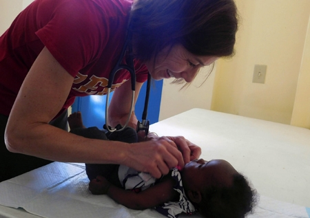 A nurse treats a child in Haiti