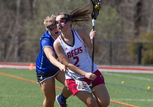 woman lacrosse player running