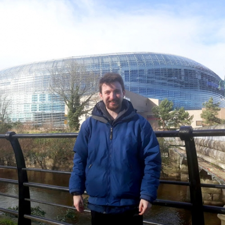 Conor Breen '21 poses in front of the dome of Aviva Stadium in Dublin