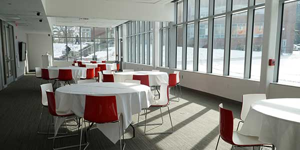 A photo of the Maria Hall multipurpose room with tables set out for an event